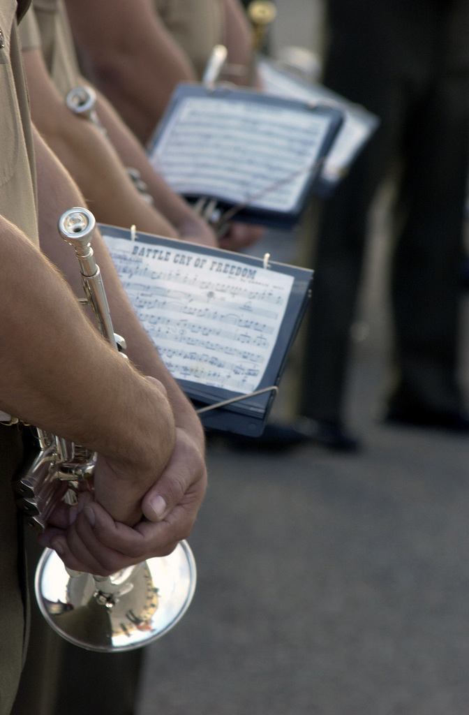 U.S. Marine Corps personnel with the Marine Band San Diego stand at parade rest with just their instruments and music sheets visible, during the Friday morning colors ceremony at the Marine Corps Recruit Depot, San Diego, Calif. on Nov. 12, 2004.  (U.S. Marine Corps official photo by Lance Corporal Jared M. Padula) (Released)
