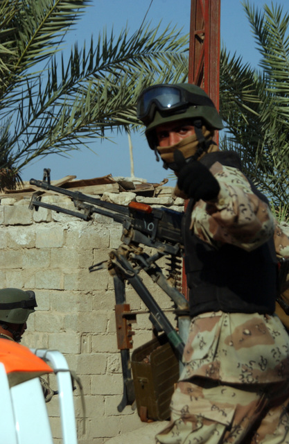 A soldier from the 6th Battalion, New Iraqi Army gives the photographer a thumbs up after a succesful raid on an suspected insurgent's house in Al Karmah, which is on the out skirts of Fallujah during combat operation on Nov. 15, 2004 during Operation Iraqi Freedom. (U.S. Army photo by SGT. 1ST Class Johancharles Van Boers) (Released)