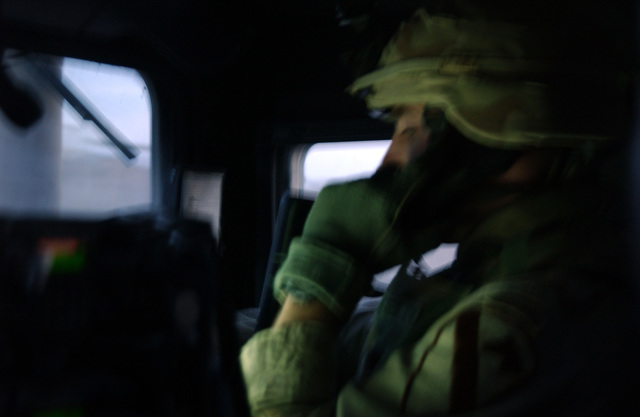 A soldiers from 1-5 Cav, 2nd BCT, 1ST Cav Div calls in the inforamtion about the suspected insurgents that where captured by the soldiers of the 6th Battalion, New Iraqi Army on a raid of a suspected insurgent's house in Al Karmah, which is on the out skirts Fallujah during combat operation on Nov. 15, 2004 during Operation Iraqi Freedom. (U.S. Army photo by SGT. 1ST Class Johancharles Van Boers) (Released)