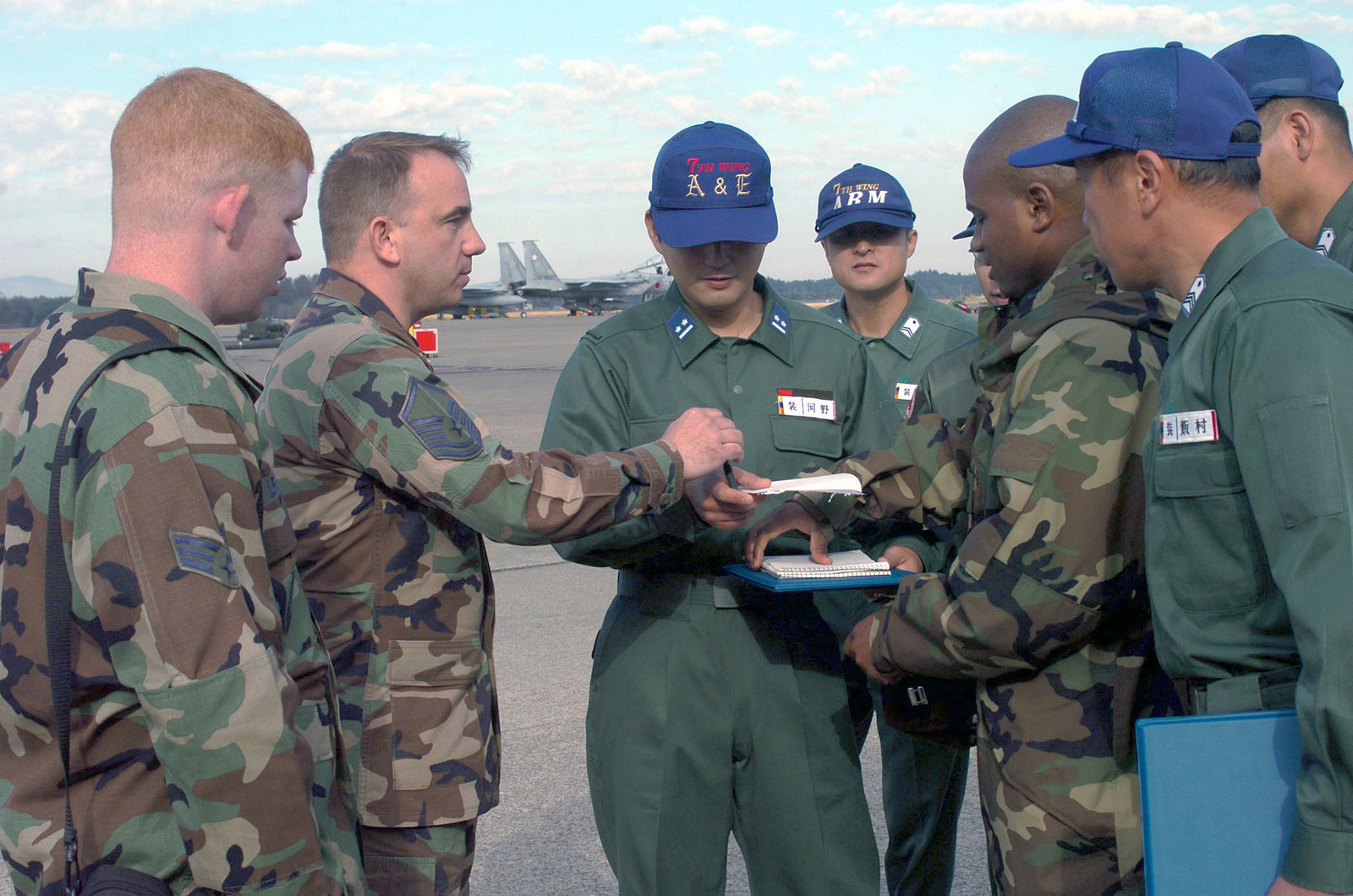 U.S. Air Force personnel together with Japan Air Self-Defense Force troops exchange information on exercise procedures during exercise Keen Sword 05 at Hyakuri Japanese Air Base, Japan, on Nov. 17, 2004.(U.S. Air Force PHOTO by MASTER SGT. Val Gempis) (Released)
