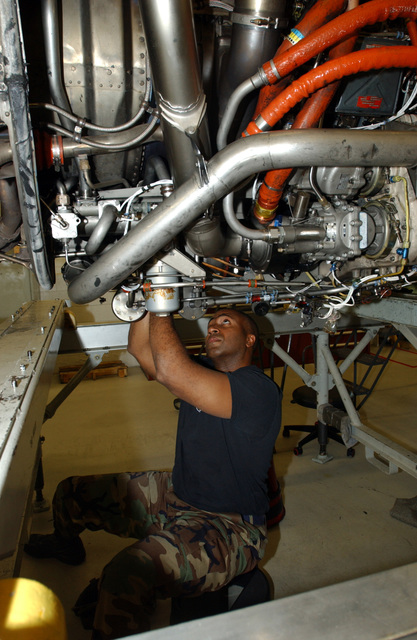 U.S. Air Force STAFF SGT. Darrin Brooks, from the 436th Component Maintenance Squadron, repairs a generator harness on an engine of a C-5 Galaxy cargo aircraft at Dover Air Force Base, Del., on Nov. 17, 2004. (PHOTO by Jason Minto, CIV) (Released)