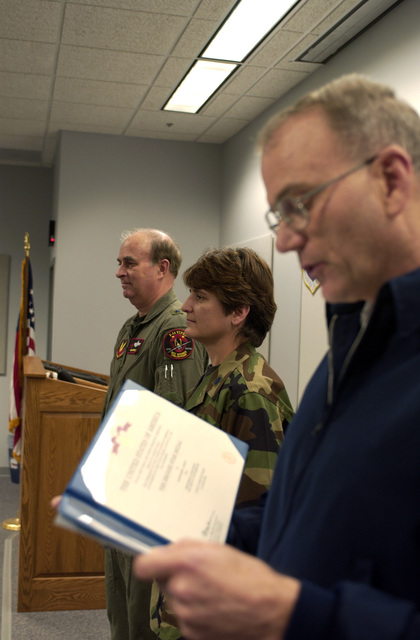 LT. COL. Robin Hosch (center), Commander of the 133rd Test Squadron, Iowa Air National Guard, receives the Bronze Star Medal, on Nov. 18, 2004, for her actions while she was deployed at Baghdad International Airport, Iraq. Reading the citation is COL. Dennis Menefee of the 185th Air Refueling Wing, and presenting the award is Brig. GEN. Douglas Pierce of the 132nd Fighter Wing, at Des Moines, Iowa. The ceremony took place at the 185th ARW at Sioux City, Iowa. (USAF PHOTO by MASTER SGT. Vincent De Groot) (Released)