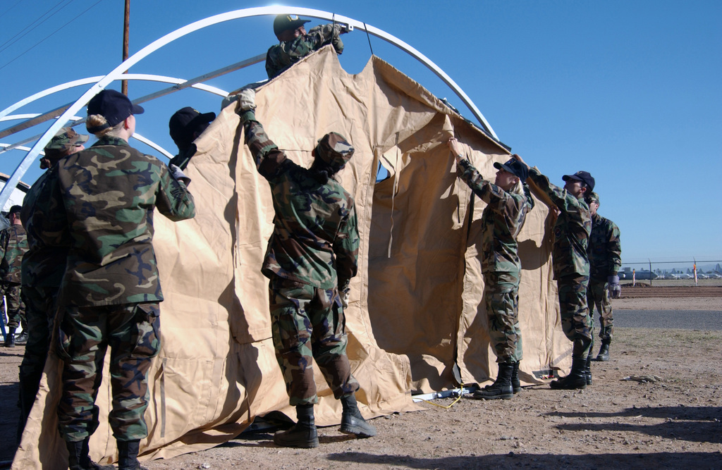 U.S. Air Force Airmen assigned to the 355th Medical Support Squadron put up a tent facility to be used for patient care during a Medical Unit Readiness Training (MURT) at Davis-Monthan Air Force Base, Ariz., on Nov. 19, 2004. (USAF PHOTO by AIRMAN 1ST Class Christina D. Kinsey) (Released)