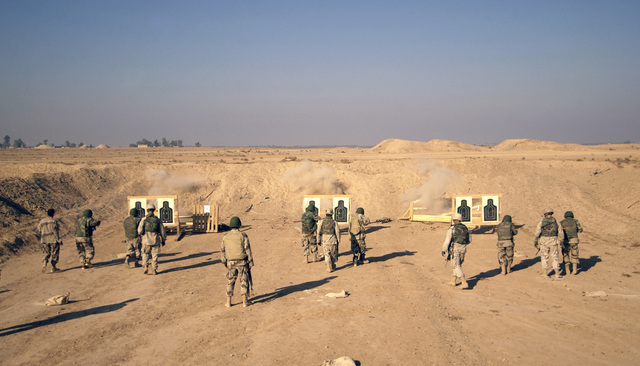 US Army (USA) Soldiers assigned to Charlie Troop, 1-4 Cavalry, 1ST Infantry Division, conduct weapons firing training with Iraqi National Guard (ING) Soldiers assigned to D/201st at Forward Operating Base Wilson, Iraq, during Operation IRAQI FREEDOM