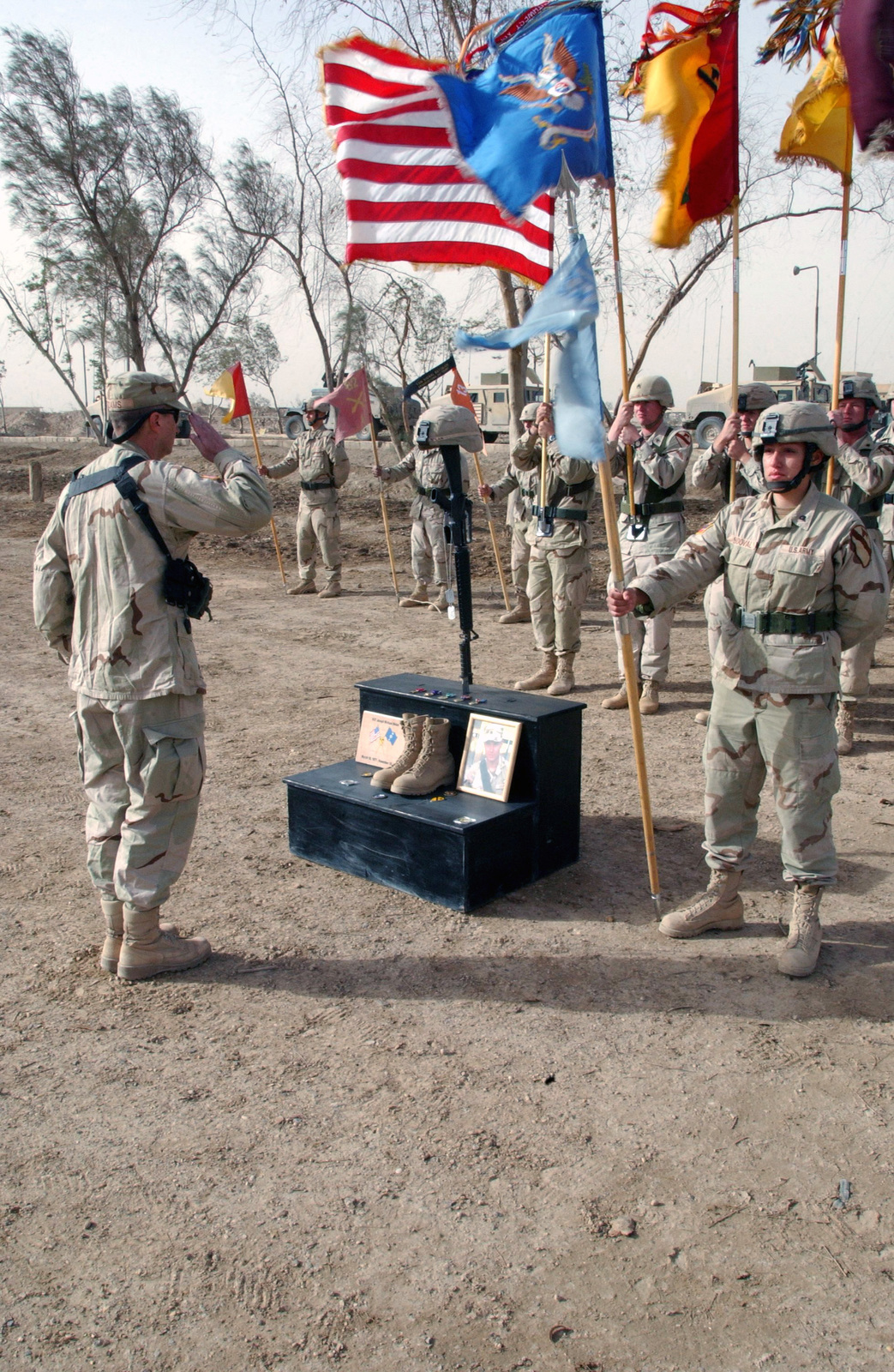 U.S. Army Soldiers pay tribute to U.S. Army SGT. Joseph Michael Nolan during a field memorial service at Camp Fallujah, Iraq, on Nov. 23, 2004. SGT. Nolan, who was assigned to Bravo Company, 312th Military Intelligence Battalion, 2nd Brigade Combat Team, 1ST Cavalry Regiment, 1ST Infantry Divison, was killed in the line of duty on Nov. 18, 2004, near the city of Fallujah, Iraq. (USAF PHOTO by SENIOR AIRMAN Christopher A. Marasky) (Released)