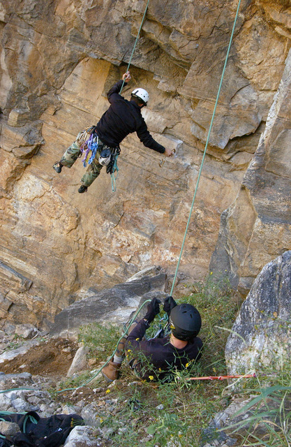 U.S. Air Force CAPT. Stephen Savell (bottom) and SENIOR AIRMAN Kenny Ortega, both members of the 563rd Rescue Group at Davis-Monthan Air Force Base, Ariz., rappel from the side of Mt. Lemmon during training at Tucson, Ariz., on Nov. 24, 2004. (USAF PHOTO by AIRMAN Veronica Pierce) (Released)