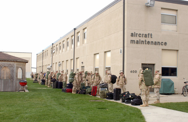 Members of the 115th Fighter Wing, Wisconsin Air National Guard, wait in line at Truax Field Air National Guard Base, Wis., on Nov. 30, 2004, before completing their final outprocessing procedures before their Aerospace Expeditionary Force (AEF) deployment to an undisclosed location. (USAF PHOTO by SENIOR AIRMAN Hannah McGhee) (Released)