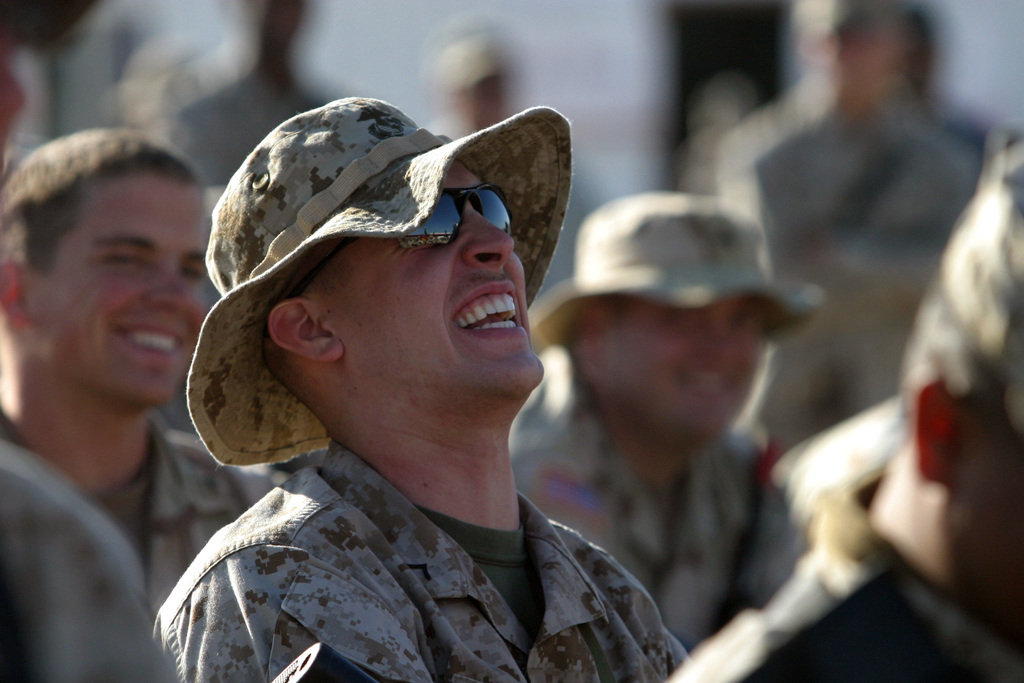 A U.S. Marine Corps PFC. sits back and laughs at jokes from comedians of The Comics On Duty World Tour, at Camp Taqaddum, Iraq, on Dec. 2, 2004.  Since their first performance in 1992, the Comics On Duty World Tour, has performed over 1,350 shows worldwide and entertained over a hundred thousand military personnel. (U.S. Marine Corps PHOTO by Lance CPL. Samantha L. Jones) (Released)