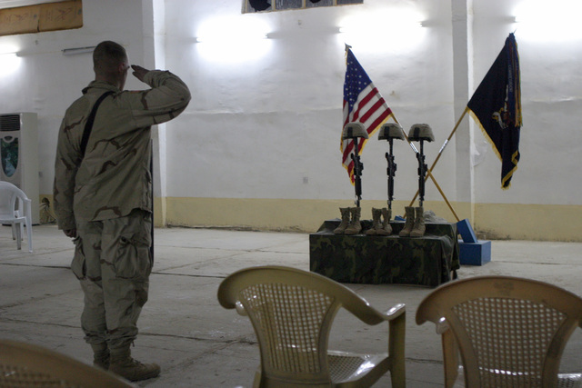 A U.S. Army Soldier with the 1ST Battalion, 503rd Infantry Regiment, 2nd Infantry Division, salutes at a memorial service for STAFF SGT. Michael B. Shackelford, SGT. Carl Wayne Lee, and PFC. Stephen C. Benish, near the town of Ar Ramadi,  Iraq, during Operation Al Fajr, in support of Operation IRAQI FREEDOM on Dec. 3, 2004.(U.S. Marine Corps official photo by Lance CPL. Andrew D. Young)(Released)