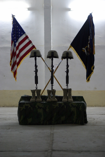 The helmets, boots and rifles for U.S. Army STAFF SGT. Michael B. Shackelford, SGT. Carl Wayne Lee, and PFC. Stephen C. Benish,1ST Battalion, 503rd Infantry Regiment, 2nd Infantry Division, are displayed during a memorial service held at near the town of Ar Ramadi, Iraq, during Operation Al Fajr, in support of Operation IRAQI FREEDOM on Dec. 3, 2004.(U.S. Marine Corps official photo by Lance CPL. Andrew D. Young)(Released)