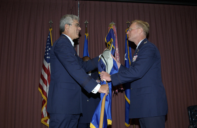 U.S. Air Force Air University Commander LT. GEN. Regni (left), gives command of the College of Aerospace Doctrine, Research and Education to COL. David Fadock (right), at Maxwell Air Force Base, Ala., on Dec. 3, 2004.(U.S. Air Force PHOTO by D. Burnett, CIV.) (Released)