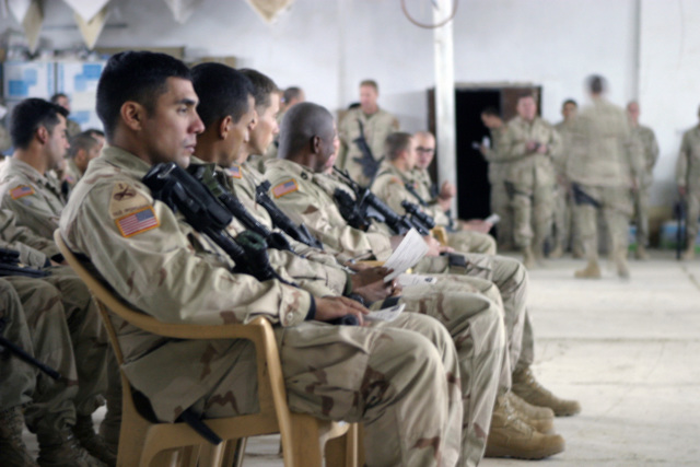 U.S. Army Soldiers with the 1ST Battalion, 503rd Infantry Regiment, 2nd Infantry Division, attend a memorial service for STAFF SGT. Michael B. Shackelford, SGT. Carl Wayne Lee, and PFC. Stephen C. Benish, near the town of Ar Ramadi,  Iraq, during Operation Al Fajr, in support of Operation IRAQI FREEDOM on Dec. 3, 2004.(U.S. Marine Corps official photo by Lance CPL. Andrew D. Young)(Released)