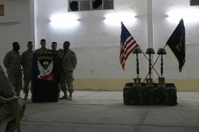 U.S. Army Soldiers with the 1ST Battalion, 503rd Infantry Regiment, 2nd Infantry Division, sing at a memorial service for STAFF SGT. Michael B. Shackelford, SGT. Carl Wayne Lee, and PFC. Stephen C. Benish, near the town of Ar Ramadi,  Iraq, during Operation Al Fajr, in support of Operation IRAQI FREEDOM on Dec. 3, 2004.(U.S. Marine Corps official photo by Lance CPL. Andrew D. Young)(Released)