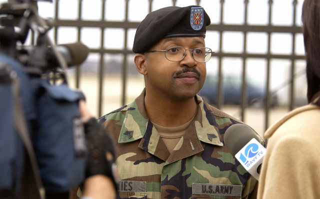 WAVY TV News Channel 10 interviews Army National Guardsman 1ST Security Forces Squadron SGT Joseph Arties, III, after a two year deployment at Langley Air Force Base, Va., on Dec. 6, 2004.(U.S. Air Force Photograph by AIRMAN 1ST Class Austin Knox) (Released)