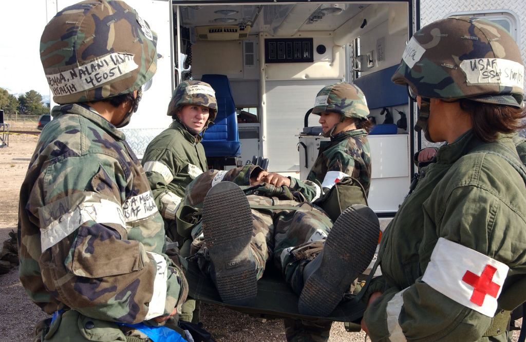 U.S. Air Force 355th Medical Group personnel practice loading litters onto an ambulance during the 355th Wing Exercise BUSHWACKER 05-02 at Davis-Monthan Air Force Base, Ariz., on Dec. 7, 2004. (U.S. Air Force PHOTO by AIRMAN Veronica Pierce) (Released)
