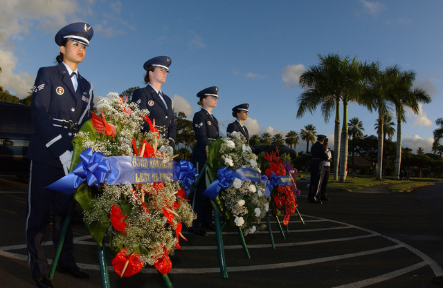 U.S. Air Force Hickam Honor Guard SENIOR Airmen Jodi Asprer, April Bonaparte, Ocasio Gonzalea, and AIRMAN 1ST Class Jennifer Kinkaid, stand by to bear the wreaths during the 63rd anniversary of the attack on Hickam Field, at Hickam Air Force Base, Hawaii, on Dec. 7, 2004. (U.S. Air Force PHOTO by Mysti Bicoy, CIV.) (Released)