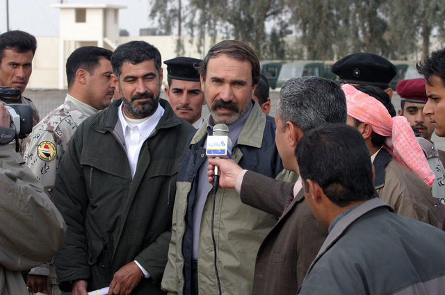 An Iraqi news reporter interviews an Iraqi male civilian, who was one of many former prisoners recently released from Abu Ghurayb (Abu Ghraib) Prison, upon his arrival in Ar Ramadi, Al Anbar Province, Iraq, after serving an 18 month prison sentence during Operation IRAQI FREEDOM
