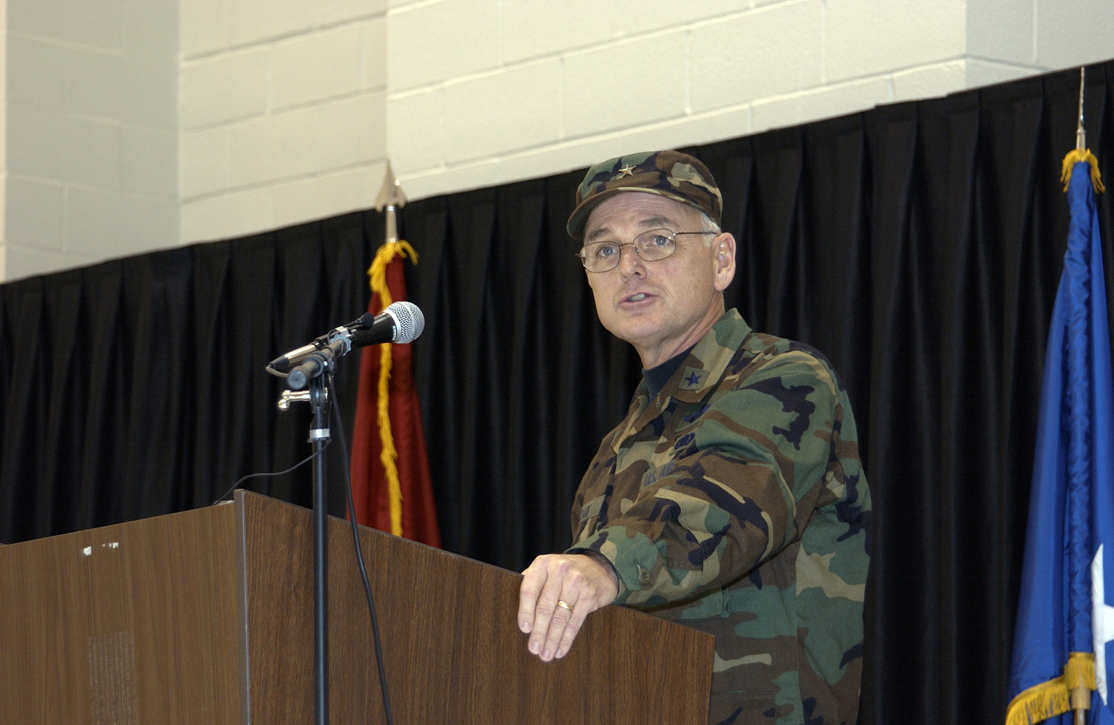 U.S. Air Force Brig. GEN. Kenneth Clark delivers a speech during the Adjutant General Change of Command ceremony at the New Hampshire Army Aviation Hangar at Concord, N.H., on Dec. 12, 2004. This day is monumental for the state of New Hampshire because this is the first time in its history where an Air Force general was selected to serve as the TAG. (USAF PHOTO by STAFF SGT. Dawn Finniss) (Released)