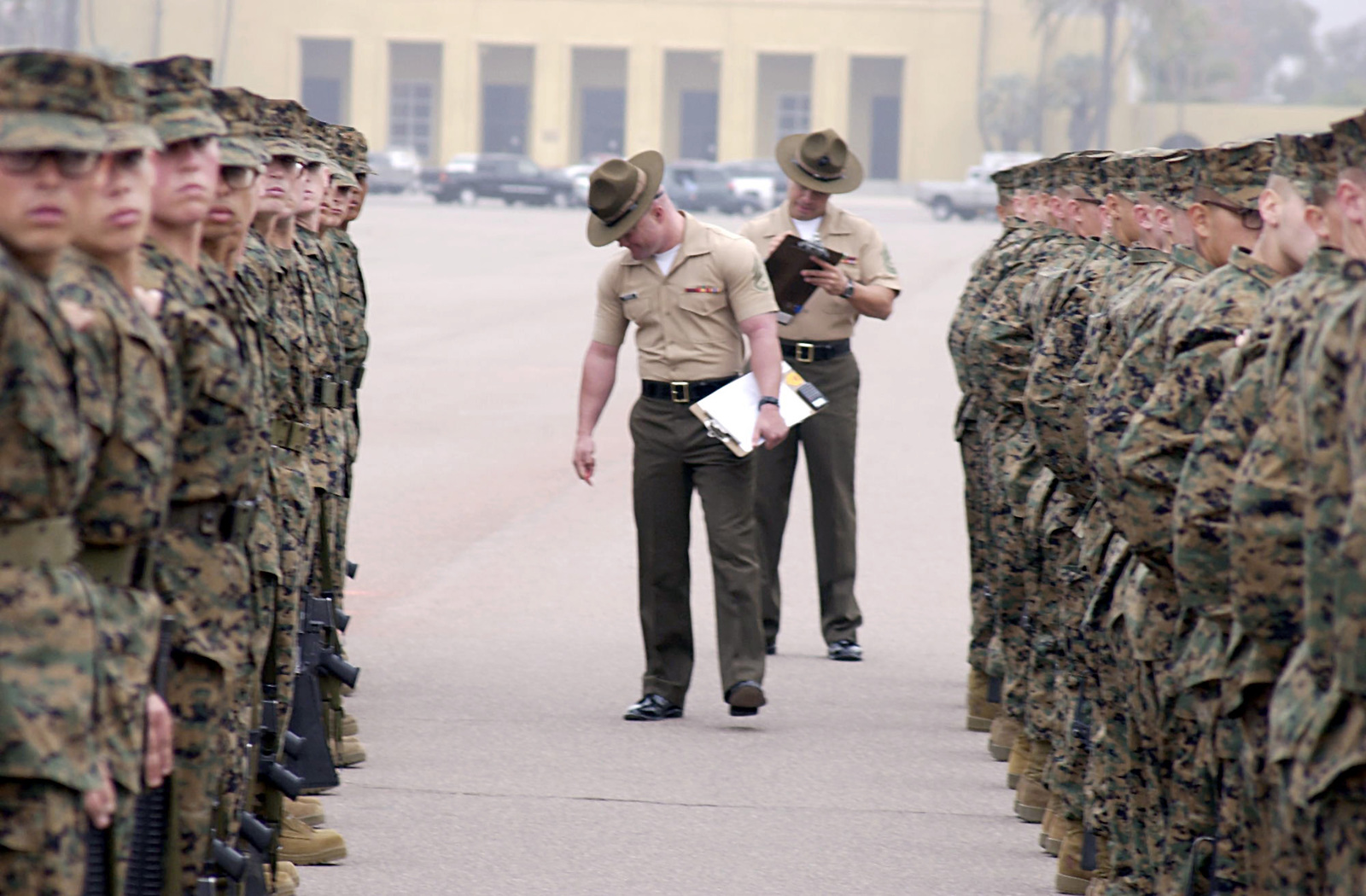 US Marine Corps (USMC) Drill Masters aboard Marine Corps Recruit Depot (MCRD) San Diego, California (CA), grades recruits from Lima/Company during their final drills