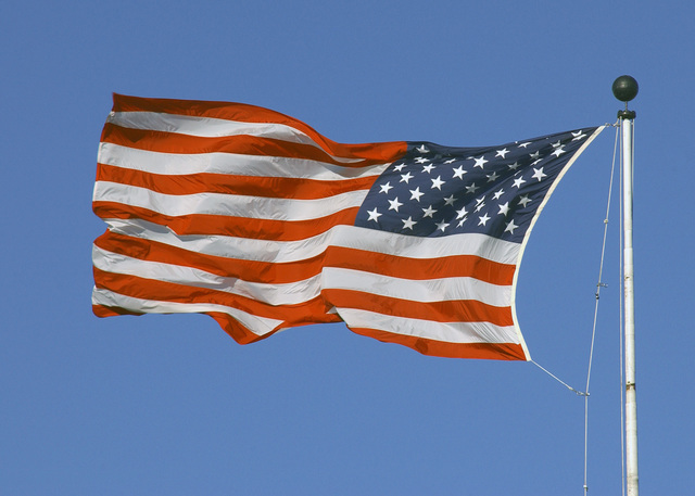 A large American flag flies at Randolph Air Force Base, Texas, on December 14, 2004. (DOD photo by David Terry) (Released)