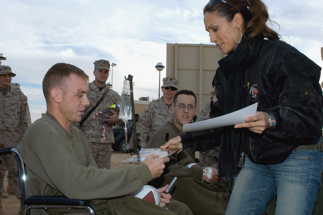 "Fox Sports Net's""Best Damn Sports Show""Co-host and Model, Leeann Tweeden, autographs photos for troops outside the Base Theater during the Holiday Handshake Tour. Al Asad, Al Anbar Province, Iraq. Dec. 14, 2004. (U.S. Marine Corps photo by Lance CPL. William Dubose) (Released)"