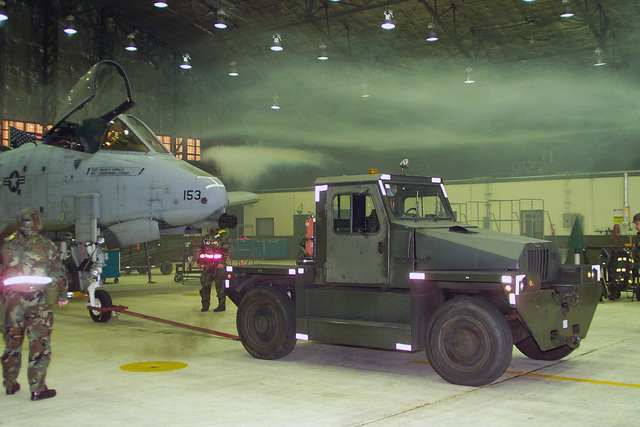 U.S. Air Force Airmen from the 51st Maintenance Squadron uses a tow tractor to evacuate an A/OA-10/A Thunderbolt II aircraft during simulated fire inside a hangar during Exercise Beverly Midnight 04-07 at Osan Air Base, Korea on Dec. 14, 2004. (USAF PHOTO by STAFF SGT. Bradley C. Church) (Released)