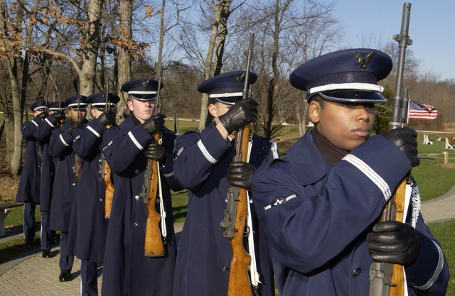 U.S. Air Force (USAF) Elite Honor Guard personnel from the 305th Air Mobility Wing, McGuire Air Force Base, N.J., hold their 7.62 M14 ceremonial rifles during a military funeral training at the Brigadier William Doyle Veterans Cemetery, Arneytown, N.J., on Dec. 15, 2004. The 305th AMW Honor Guard conduct about 122 military funeral honors per month. (USAF PHOTO by Denise Gould) (Released)