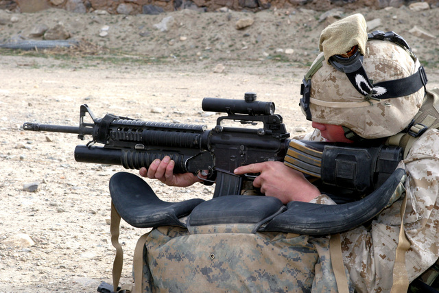 U.S. Marine Corps CPL. David Perinscief, a Rifleman with India Company, 3rd Battalion 3rd Marine Regiment, check the scope on his 5.56 mm M16A4 rifle, equipped with a 40 mm M203 grade launcher, as he provides security during landing drills at Camp Eggers in Asadabad, Afghanistan, on December 17, 2004. U.S. Marine Corps, 3rd Battalion, 3rd Marine Regiment Marines are conducting security and stabilization operations in Afghanistan, in support of Operation Enduring. (U.S. Marine Corps photo by Lance CPL. James L. Yarboro) (Released)