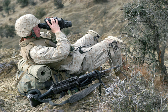 US Marine Corps (USMC) Private First Class (PFC) Shane Carver, a Rifleman with Weapons Company, 3rd Battalion, 3rd Marine Regiment, uses an AN/PBS-13 optic device to scan the area for any enemy activity during a security operation in the Khowst Province, in Afghanistan. USMC Marines assigned to 3rd Battalion, 3rd Marines are conducting Security And Stabilization Operations (SASO) in the Khowst Province of Afghanistan in support of Operation ENDURING FREEDOM. PFC Carver is armed with a 5.56mm M249 Squad Automatic Weapon (SAW)