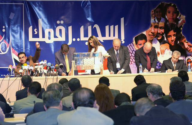 Members of the Iraqi Elections Independent Council (IECI) held a lottery to determine the placement of political entities on the ballot for upcoming elections at the Baghdad Convention Center in Baghdad, Iraq, on Dec. 20, 2004. (USAF PHOTO by MASTER SGT. Michael E. Best) (Released)