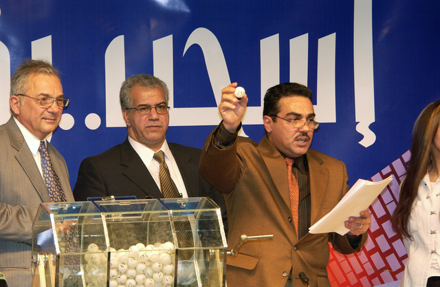 Members of the Iraqi Elections Independent Council (IEIC) held a lottery to determine the placement of political entities on the ballot for upcoming elections at the Baghdad Convention Center in Baghdad, Iraq on Dec. 20, 2004. (USAF PHOTO by MASTER SGT. Michael E. Best) (Released)