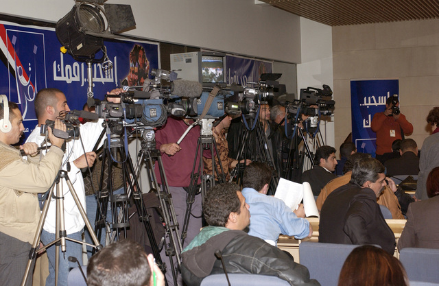Members of the media cover the Iraqi Elections Independent Council (IECI)  lottery to determine the placement of political entities on the ballot for upcoming elections at the Baghdad Convention Center in Baghdad, Iraq, on Dec. 20, 2004.  (USAF PHOTO by MASTER SGT. Michael E. Best) (Released)