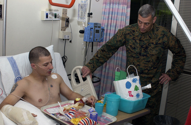 U.S. Marine Corps Brigadier General Paxton takes time to visit wounded Marines from Operation Iraqi Freedom at Balboa Naval Hospital in San Diego, Calif. Dec. 21, 2004. (U.S. Marine Corps photo by CPL. Jared Padula) (Released)
