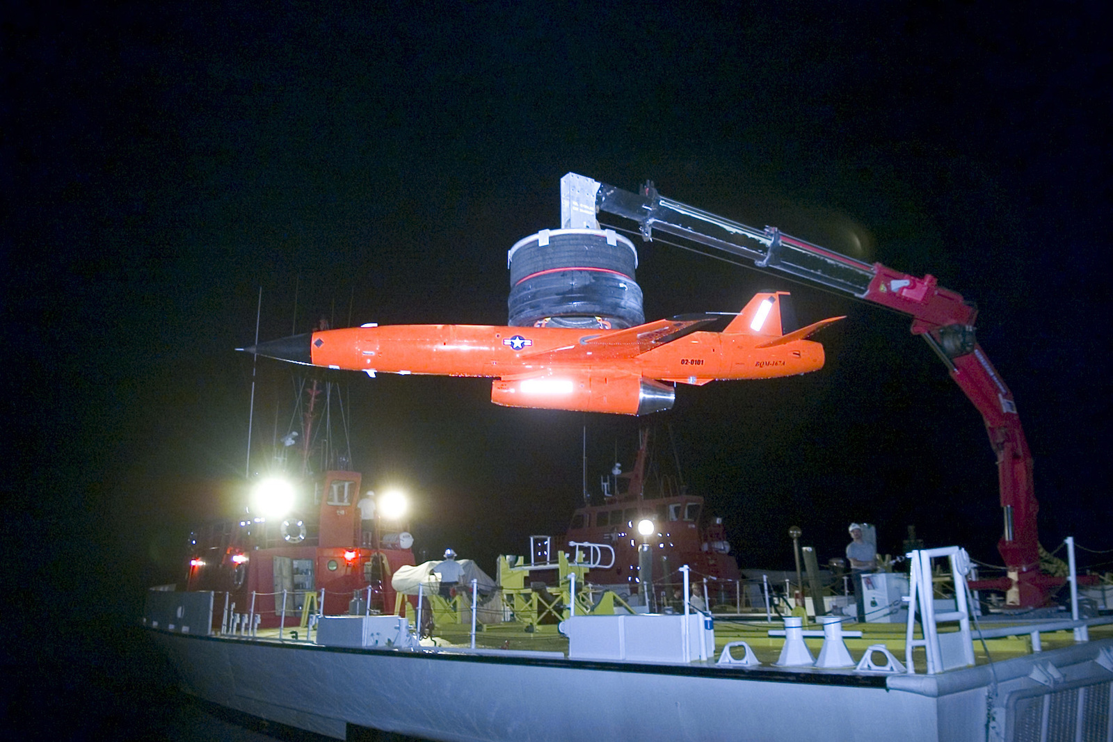A U.S. Air Force BQM-167A Unmanned Aerial Vehicle (UAV) is recovered on a boat at