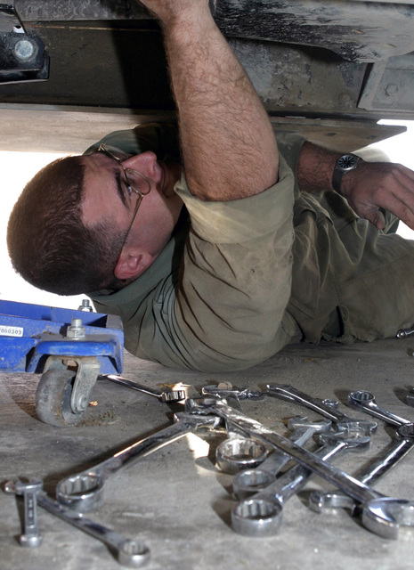 us marine corps sgt estevan perez a diesel mechanic with 3rd battalion 3rd marines works hard to fix a broken steering gear one of the high mobility