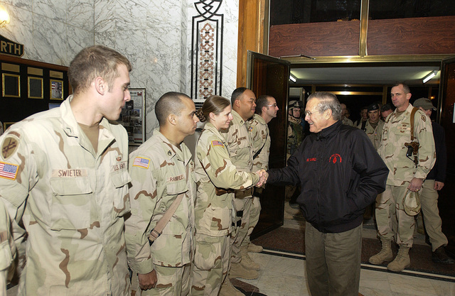 The Honorable Donald H. Rumsfeld, U.S. Secretary of Defense, meets with Soldiers from the 1ST Brigade, 25th Infantry Division, during a surprise visit to Mosul, Iraq, on Christmas Eve, December 24, 2004, to show his support to service members in the field. (DoD photo by MASTER SGT. James M. Bowman) (Released)