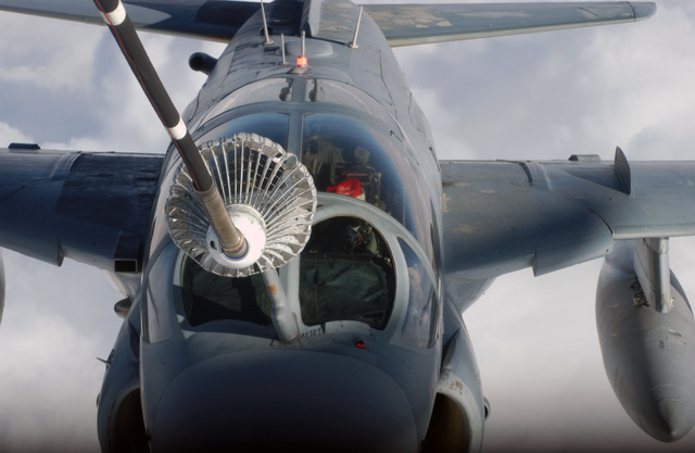 A U.S. Navy EA-6B Prowler aircraft receives fuel from a U.S. Air Force KC-10A Extender aircraft with the 908th Expeditionary Aerial Refueling Squadron during a refueling mission over Iraq on Dec. 25, 2004. (USAF PHOTO by SENIOR MASTER SGT. Mark Moss) (Released)