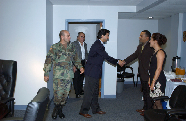 Mr. Luis Fortuno (center, blue jacket), Resident Commissioner of Puerto Rico to the United States Congress, is greeted at Fort Buchanan, P.R., on Dec. 29, 2004.  U.S. Army COL. Stephen M. Ackman (foreground, left), Commander, U.S. Army Garrison, is escorting Mr. Fortuno around post.  (U.S. Army photo by Marcos Orengo) (Released)