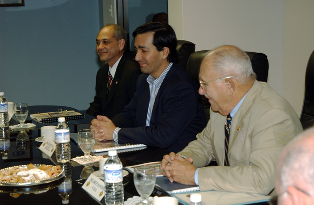 Mr. Luis Fortuno (center), Resident Commissioner of Puerto Rico to the United States Congress, U.S. Army MAJ. GEN. (Ret.) Felix Santoni (right), Civilian Aide to the Secretary of the Army, and Mr. Michael Hernandez (rear), Operations Manager, Fort Buchanan, P.R., attend a Command Briefing at Fort Buchanan on Dec. 29, 2004. (U.S. Army photo by Marcos Orengo) (Released)