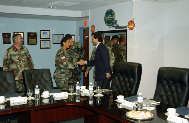 Mr. Luis Fortuno (foreground, blue jacket), Resident Commissioner of Puerto Rico to the United States Congress, shakes hands with U.S. Army COL. Garcia, Commander, 65th Regional Readiness Command, during a visit to Fort Buchanan, P.R., on Dec. 29, 2004. (U.S. Army photo by Marcos Orengo) (Released)