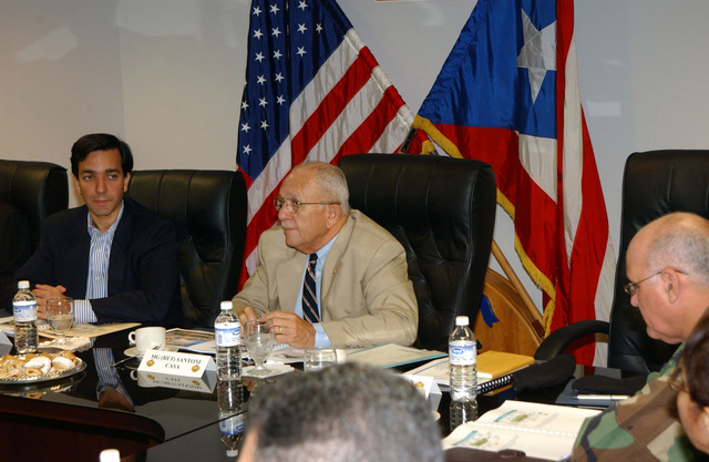 Mr. Luis Fortuno (left), Resident Commissioner of Puerto Rico to the United States Congress, and U.S. Army MAJ. GEN. (Ret.) Felix Santoni (center), Civilian Aide to the Secretary of the Army, attend a Command Briefing at Fort Buchanan, P.R., on Dec. 29, 2004. (U.S. Army photo by Marcos Orengo) (Released)
