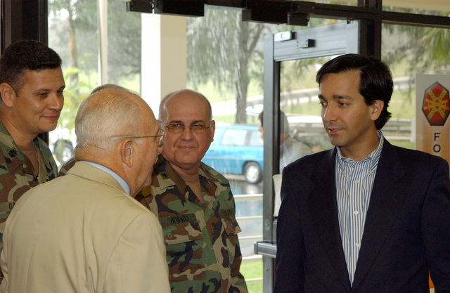 Mr. Luis Fortuno (right), Resident Commissioner of Puerto Rico to the United States Congress, speaks with U.S. Army MAJ. GEN. (Ret.) Felix Santoni (foreground, yellow), Civilian Aide to the Secretary of the Army, after the Command Briefing at Fort Buchanan, P.R., on Dec. 29, 2004. (U.S. Army photo by Marcos Orengo) (Released)