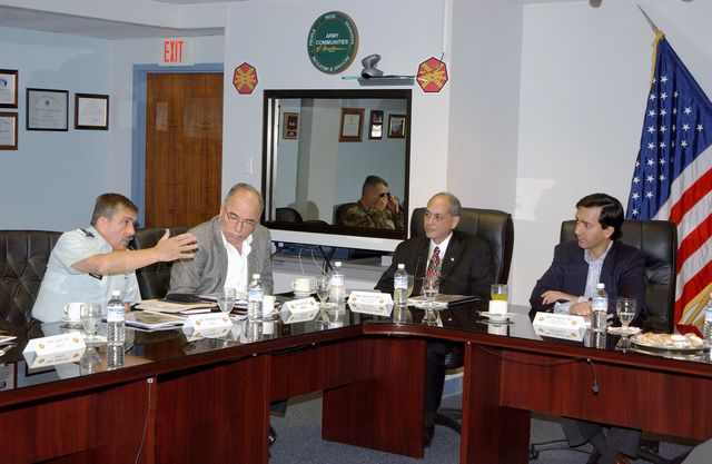 U.S. Army Brig. GEN. Marquez, Puerto Rico Army National Guard (PRANG), shares his opinion with Mr. Luis Fortuno (right), Resident Commissioner of Puerto Rico to the United States Congress, at the Command Briefing at Fort Buchanan, P.R., on Dec. 29, 2004. (U.S. Army photo by Marcos Orengo) (Released)