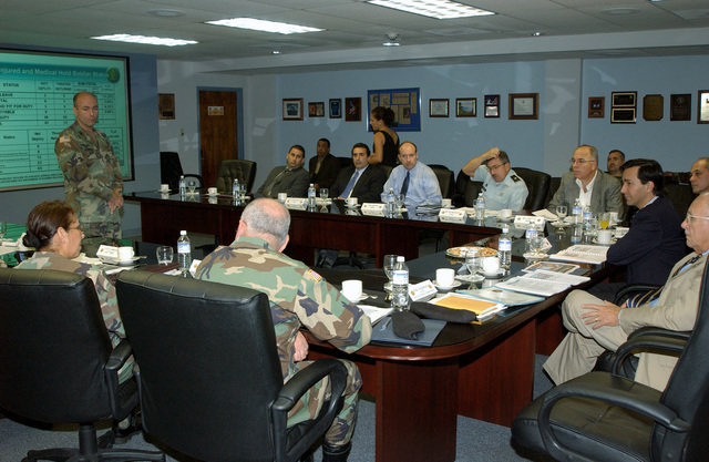 U.S. Army COL. Stephen M. Ackman (background, left), Commander, U.S. Army Garrison, leads the Command Brief for Mr. Luis Fortuno (right, blue jacket), Resident Commissioner of Puerto Rico to the United States Congress, at Fort Buchanan, P.R., on Sept. 29, 2004. (U.S. Army photo by Marcos Orengo) (Released)