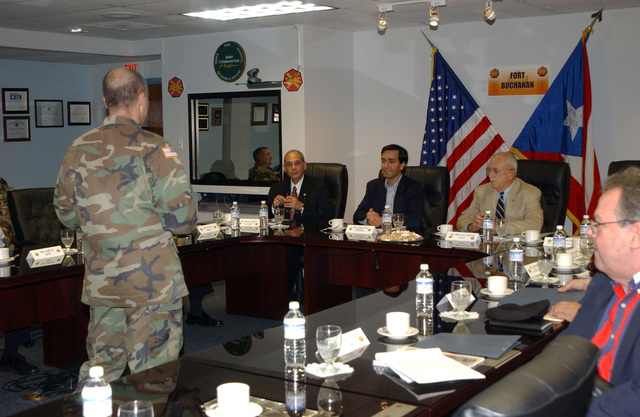U.S. Army COL. Stephen M. Ackman (left), Commander, U.S. Army Garrison, leads the Command Brief for Mr. Luis Fortuno (center, blue jacket), Resident Commissioner of Puerto Rico to the United States Congress, at Fort Buchanan, P.R., on Dec. 29, 2004. (U.S. Army photo by Marcos Orengo) (Released)