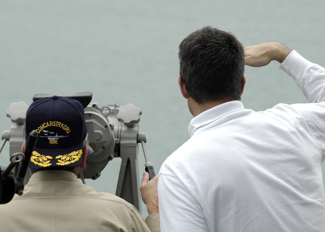 US Navy (USN) Rear Admiral (lower half) (RDML) William D. Crowder (left), Commander Carrier Strike Group 9 (CSG-9), and USN Captain (CAPT) David Lausmann, CVN 72 Executive Officer, survey damage along the coast of Banda Aceh, Sumatra, Indonesia, from the O-10 level onboard the Nimitz Class Aircraft Carrier USS ABRAHAM LINCOLN (CVN 72). The Lincoln Carrier Strike Group (CSG) is currently operating in the Indian Ocean off the waters of Indonesia and Thailand in support of Tsunami Humanitarian Relief Efforts