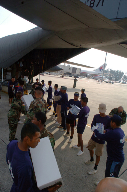U.S. military personnel from the Joint POW/ MIA Command (JPAC) Mortuary Affairs team Thai military personnel unload supplies from a C-130 Hercules cargo aircraft during Operation Unified Assistance at Phuket, Thailand, on Jan. 3, 2005. The JPAC team, that include doctors and forensic specialists, will help identify the bodies of westerners that were killed by the tsunami here. More than 18,000 U.S. military personnel are providing humanitarian assistance in Southwest Asia after a 9.0 magnitude earthquake on Dec. 26, 2004, triggered devastating tsunamis that killed over 250,000 people in the region. (USAF PHOTO by TECH. SGT. Cohen A. Young) (Released)