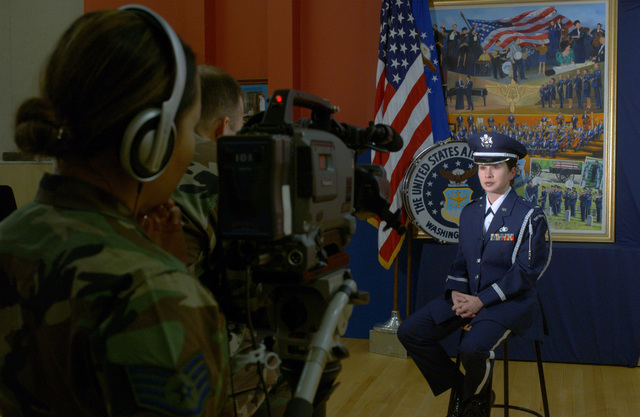 U.S. Air Force 1ST LT. Christina Moore, a USAF Band Flight Commander, conducts an interview with the Army and Air Force Hometown News Service personnel after a band rehearsal at Bolling Air Force Base, Washington, D.C., on Jan. 4, 2005. The band is practicing for the upcoming 55th Presidential Inauguration on Jan. 20, 2005. (USAF PHOTO by STAFF SGT. Jacob N. Bailey) (Released)