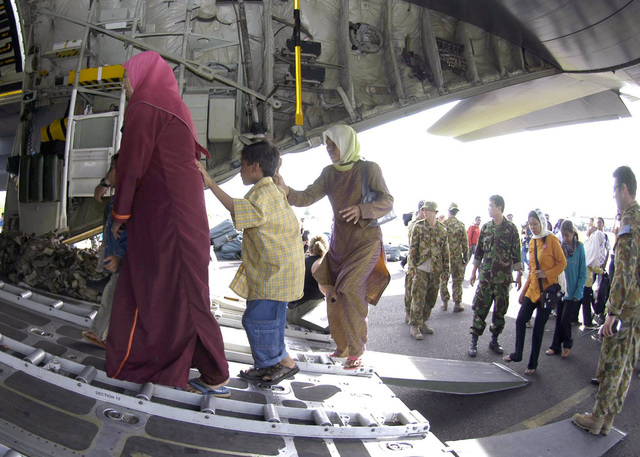 Australian Military personnel help Tsunami victims board a C-130 Hercules cargo aircraft for a flight from Sultan Iskandar Muda Air Force Base (AFB) in Banda Aceh to Jakarta, Indonesia (IDN). Medical teams from USS ABRAHAM LINCOLN (CVN-72), Carrier Air Wing Two (CVW-2) and the International Organization for Migration (IOM) set-up a triage site on Sultan Iskandar Muda Air Force Base (AFB), in Banda Aceh, Sumatra