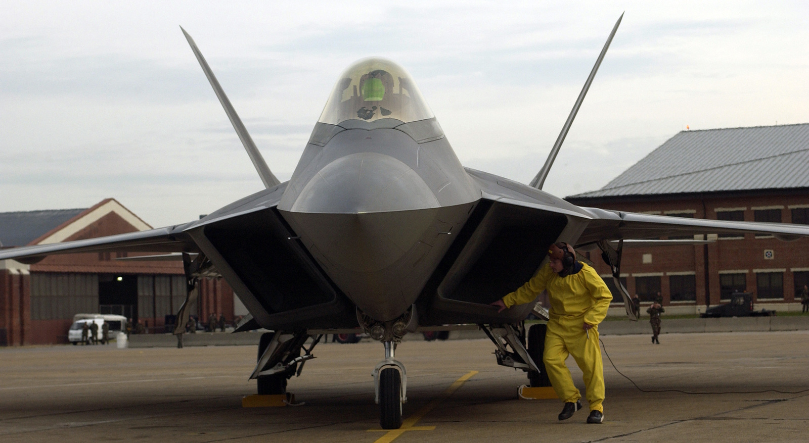 U.S. Air Force COL. Joe Lanni, Commander of the 412th Test Wing, Edwards Air Force Base, Calif., holds his position while maintenance crew of the 27th Fighter Squadron safe up his F/A-22 Raptor fighter aircraft at Langley Air Force Base (AFB), Va., on Jan. 7, 2005. COL. Lanni landed the first FA-22 Raptor officially assigned to the 1ST Fighter Wing here at Langley AFB. (USAF PHOTO by STAFF SGT. Samuel Roger) (Released)